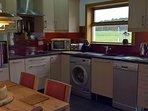 Kitchen with eye level electric oven, ceramic hob, dishwasre & washing machine