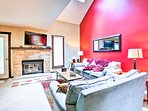 The flat-screen cable TV and fireplace make the living room a cozy space.
