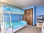 A third bedroom hosts 2 twin-over-queen bunk beds, a TV and DVD player.