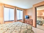 The bedroom includes a double closet and flat-screen TV.