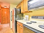 The fully equipped kitchen boasts pots, pans, crock pots, a blender and more.