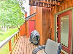 The furnished back deck boasts a gas grill and an equipment locker.