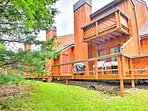 A spacious deck and balcony overlook the tranquil Boulder Lake area.