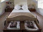 Beautiful top floor bedroom with soft lighting.