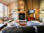 Cozy lounge area with gas fireplace and flat screen TV