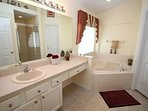 Master Suite 1 - En-suite Bathroom; relax and unwind in the gorgeous tub.
