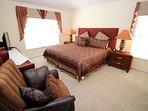 Master Suite 1 with comfortable King bed, TV and en-suite Bathroom