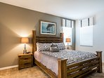 Master Suite 1 with King Bed, TV, walk in closet and en-suite bathroom  (located on the ground floor)