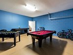 Games room featuring pool table, foosball and air hockey