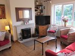 Lounge Area with Inset solid-fuel stove, large TV, games & books shelves