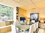 A dining area with plenty of natural light....