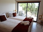 Twin bedroom, opens out to large sun terrace, with outdoor seating