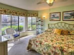 Drift to sleep in the spacious master bedroom with a king bed.