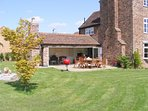 Enjoy the enclosed garden, with enough space for your family holiday. Sleeps 10 comfortably.
