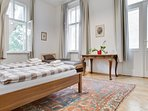 Master bedroom with view to the garden and large terrace with summner seating and barbecue