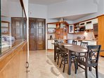Living room with fully equiped kitchen, terrace and view to old charming garden is at your disposal