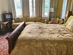 The Treetop Room has a queen-size bed, couch and desk. Luxury linens. 16 windows with garden view.