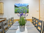 The large, dining room table seats 12 guests bar stools for 4 and outdoor banquet that seats 12 as w