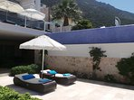 Choice of sunbathing on the pool terrace above or the private marble garden terrace below