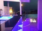 The night time view from JaySea's bar across the jacuzzi, pool and across Kalkan bay to the islands
