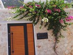 Villa JsySea's entrance with its gorgeous climbing bougainvillea