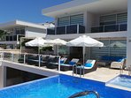 Plenty of places to relax poolside at this contemporary villa