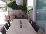 Villa JaySea has 2 alfresco dining tables: the marble tables seats 8, and the rattan table seats 6