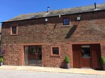 THE OLD GRAINSTORE, family accommodation, character features, woodburner, en-sui