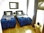 BEDROOM THREE SET UP AS TWIN ROOM