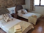 Comfortable twin bedded room with ensuite bathroom.