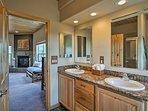 The decadent en-suite bathroom hosts a double vanity, shower and sunken tub.