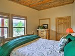 The ground floor also hosts this bedroom with a queen bed.