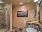 A walk-in glass-enclosed shower furnishes the full bathroom downstairs.