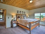 The master bedroom boasts a king bed and corner views of the property.
