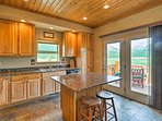 French doors open directly to the deck for easy access to dining al fresco.