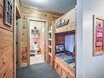 Kids can claim the twin-over-twin hallway bunks.