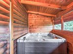 Enjoy a long soak in the private covered hot tub.