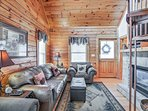 Pine-paneled ceilings add the perfect mountain ambiance to this unit.