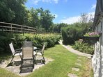 Secluded front garden is perfect for afternoon tea in the sun.  Alpaca field is right outside too!