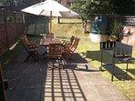 Looking from kitchen door to patio & rear garden.