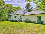 You'll love the privacy of this cottage nestled on an acre of forested land.