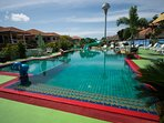 Swimming pool just 80mt from back entrance. Cost 50 BT and 20 BT for kids oer day.