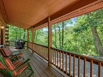 Front porch is covered, peaceful - perfect for relaxing. New 5-burner gas grill by kitchen door