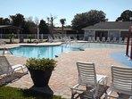 Outdoor pool alongside kids water park and pool