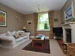 Step inside the spacious hall way with original features