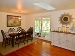Dining area opens into kitchen, sunroom and living area