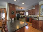 Upscale Kitchen with Dark Wood Cabinetry