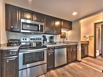 Fully Equipped Kitchen with New Stainless Steel Appliances and Granite Counters