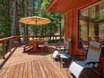 Deck with gas grill, picnic table and umbrella