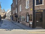 Our Local pub, antique shop, fish and chip shop and sweetie shop leading through to the town centre.